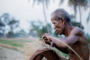 Old man are weaving bamboo wood