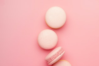 Pink macaroons on soft pink background