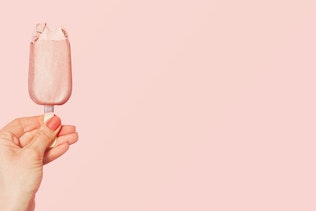 Young woman holding pink ice cream